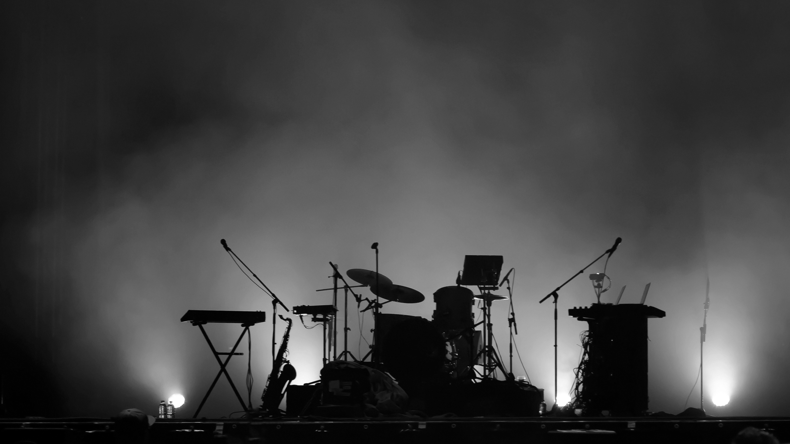 Black & White Photo of Instruments on Stage in Silhouette